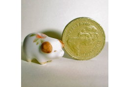 China Piggy Bank in a Brown Floral Pattern.